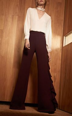 These **Alexis** Plum Karlina Ruffled Pants feature a draped panel along the left out seam, a wide leg silhouette, and a relaxed fit.