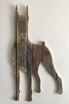 Handcrafted silhouette made from reclaimed wood.