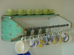 Old Carpenter's Carryall...re-purposed into a prim shelf/cup holder!!  Love this.