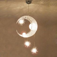 A beautiful silver aluminum moon and star light for your bedroom,dining,living or any other room in your home.   Height: 70 cm (27 inch)  Width: 35 cm (14 inch)  Length: 35 cm (14 inch)  Chain/Cord Length: Max 40 cm (16 inch)  Chain/Cord Adjustable  Number of Bulbs: 5  Wattage per Bulb: Max 20W