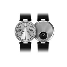 Limelight Twice double-sided watch in white gold.  Sunburst guilloché with black dial. Black roman numbers with silvered dial.  Bezel and buckle set with 106 diamonds.  2 Piaget quartz movements 56P.  Date: 2010