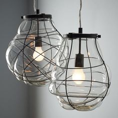 West Elm's Organic Blown Glass Pendant is created by blowing clear glass into a structured wire frame, for a lantern-like effect that glows softly and subtly when paired with vintage-style bulbs. This damp-location-listed fixture is great for porches and patios, but also works well indoors. – $169