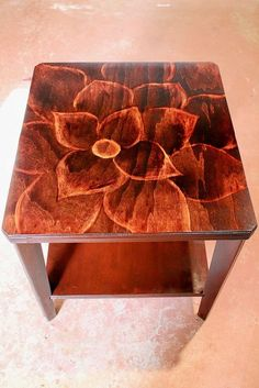 Got any old end tables lying around? Use the dremel to make the design, then stain.