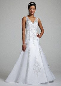 Stunning elegance meets modern decadence in this gorgeous beaded lace gown!  V neck tank bodice features all over enchanting beaded lace applique detail.  Full A-line tulle skirt adds drama and sophistication.  Chapel train. Available in White.  Fully lined. Back zip. Imported polyester. Dry clean.  To preserve your wedding dreams, try our Wedding Gown Preservation Kit.