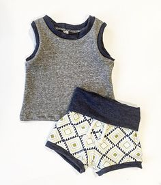 $42 Adorable gray, navy and Aztec tank top and shorties! Perfect for these upcoming