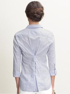 "Buttons and loops can ""tailor"" a baggie shirt. And it's cute!"