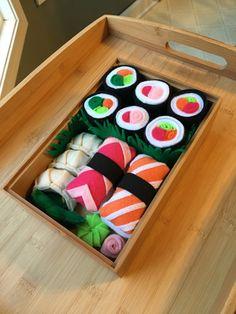 Felt sushi play set! Sushi rolls, sashimi, gyoza, edamame, AND ginger and wasabi? Yay! So. Cute.