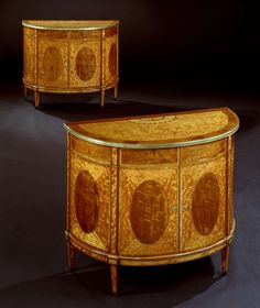 A PAIR OF GEORGE III SATINWOOD COMMODES. Circa: 1785