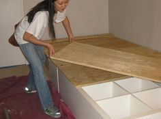 How to make your own DIY storage bed. SO perfect for hiding away shoes if you have a lot.