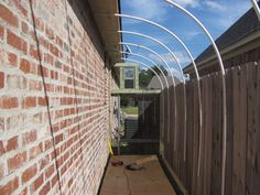 quick way to get a greenhouse down side of house. Poly pipe and shadecloth.