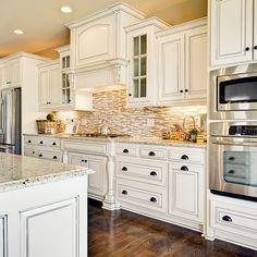 brown tones in white kitchen