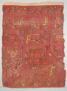 Huari textile fragment; cut out; slit tapestry with camelid wefts, 2Zs plied, 44/cm; warps are cotton, s-spun, unplied, 8-10/cm; remains of cotton...