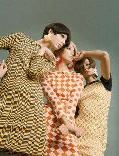 Models wearing geometric print mod dresses by Paco Rabanne, 1966.