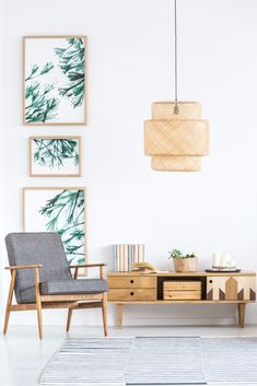 Rattan lamp above wooden cupboard and grey armchair in retro living room interior with leaves posters Zen Style, Room Decor, Wall Decor, Home Technology, Asian Decor, Hardwood Floors, Flooring, White Furniture, Modern Interior Design