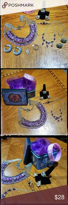 Fashion Jewelry Lot: Stylish Accent Jewelry Metal treasury tin of stylish accent jewelry: 2 silvertone amethyst necklaces Goldtone brooch 2 pairs of earrings  (1 pierce/1 clip on) Silvertone pendant  Goldtone ring/clip on earrings  Breast cancer awareness pink bracelet   1 silvertone heart shaped ring All will be packaged with care. Jewelry