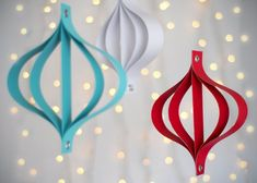 Paper ornaments - easy and really lovely. Makes me want to go out after Christmas and buy all the discounted holiday craft paper. I would also recycle Christmas cards to make them.