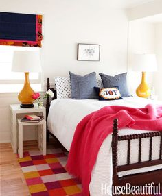 Blacks and whites and brights give this little room energy from the floor to the ceiling.