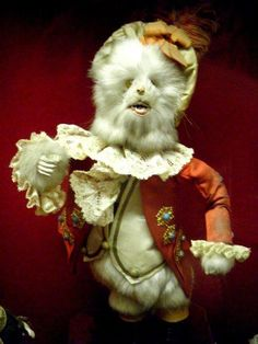 This Puss in Boots is thought to be by Decamps, of Roullet & Decamps, who were well known Parisian automaton makers. It is made from lightweight materials, covered in white fur and has very realistic teeth! He probably would have once held a mouse in one hand and a cane in the other. It is currently on display in Gallery 3 of the Museum of Childhood