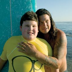 Izzy Paskowitz, the founder of Surfers Healing, and his son Isaiah (his inspiration).