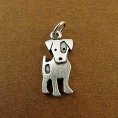 This adorable little Jack Russell is made of sterling silver. He stands about 5/8 tall, which means this is a TINY Jack Russell, but thats a big