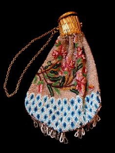 French lady's coin purse from the Napoleon III era, circa all hand beaded with exquisite motifs, and with a gilt fastener. Vintage Clutch, Vintage Purses, Vintage Bags, Vintage Handbags, Beaded Purses, Beaded Bags, Custom Purses, Textiles, Antique Clothing
