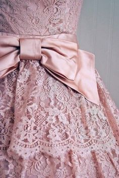 Pink lace dress with pink bow.