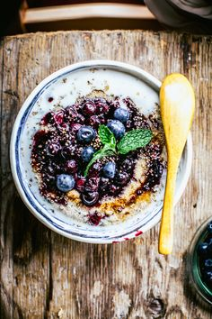 almond milk amarant porridge with poached blueberries
