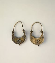 Earrings  Gold; l. 3 cm  Iran. Late 12th - early 13th century	 Source of Entry:   State Museum of Ethnography of the Peoples of the USSR, Leningrad (treasure found in the ruins of Gurgan). 1958