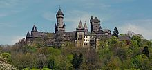 Schloss Braunfels. The castle Braunfels is located on a basalt hill west of the health resort Braunfels in Central Hesse Lahn-Dill-Kreis . Since the 13th century it is the seat of the Counts of Solms & is still in the family possession of the Counts of Oppersdorff to Solms-Braunfels. Originally a defensive castle against the counts of Nassau, it became from 1280, a residential castle of the counts of Solms. It is nestled in a forest & park landscape that surrounds the castle to the north…