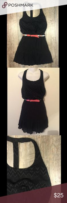 Black chevron racerback belted dress Black chevron racerback belted dress. Elastic waistband. Slip attached. 34 inches long. Cotton polyester. Tag reads medium. Dresses