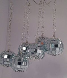 Approximately 25mm/1Disco ball, mirrored earrings. Fun to wear fashion earrings. They are designed with reflective mirror pieces that pick up colors & lights. Other disco balls 22mm https://www.etsy.com/listing/468962984/disco-balldisco-ball-earringsdisco https://www.etsy.com  Sparkle is one accessory you should never sacrifice especially during the holiday season, and these miniature mirror ball earrings make sure of it. Outfitted with a reflective...