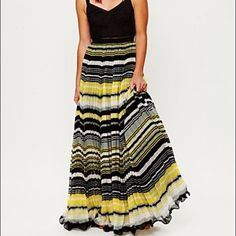 "Free people ""morning sunrays"" dress - size 12 Free people ""morning sunrays dress"" - size 12 - never worn. Lightly embroidered black bodice, pleated multi-colored, floor length skirt Free People Dresses Maxi"