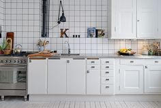 Retro industrial kitchen; love the cabinet storage -- lotta drawers, which makes your life easier.