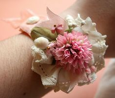 Darling vintage wrist corsage created from collected pretties. I love vintage hankies, but they often have stains in the center. What a great way to use them for a dainty little accessory. It could also be a hair ornament, an embellishment for a hat, a broach, or anything you want. I can't wait to make one for myself!