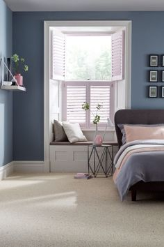 Dusty greys and blues with added hints of pale pink make the perfect calming bedroom interior. Mix different textures and modern furniture will complete the look. Our House Beautiful Shutters range is a perfect addition to the room. Blue And Pink Bedroom, Pastel Bedroom, Blue Rooms, Dusty Pink Bedroom, Bedroom Color Schemes, Bedroom Colors, Bedroom Wall, Bedroom Decor, Bedroom Ideas