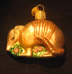 We like to decorate with critters from our own backyard. Armadillo holiday ornament, Zoo Atlanta Trading Company Gift Shop