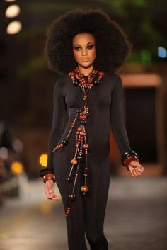 Where do I even begin??? Awesome fro, ridiculous necklace, bangin catsuit!!! #WERK