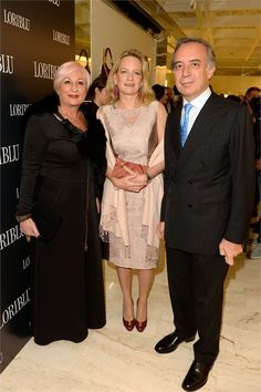 Mrs. Annarita Pilotti, H.E. Ambassador Pasquale Terracciano and his wife Mrs. Karen Lawrence Terraciano during the opening of the new boutique in London Loriblu .. Mrs Karen wearing a total look Michele Miglionico Haute Couture.