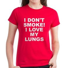 Women's dark color red t-shirt with I Don't Smoke I Love My Lungs theme. Your lungs are your internal filtration systems for your body. What happens when filters get clogged up? Quit and detox. Available in black, red, pink, navy blue, Caribbean blue, charcoal Heather grey, Kelly green; small, medium, large, x-large, 2x-large for only $26.99. Go to the link to purchase the product and to see other options – http://www.cafepress.com/stsmoke