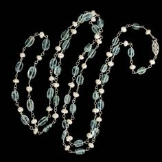 Necklace of high quality slightly graduated vintage aquamarine ovals and Japanese freshwater pearls wired on sterling silver wire and finished with a 14k white gold filigree pearl clasp.<br /><br />This style of rope necklace has been de rigueur for any woman's fashion forward jewelry wardrobe since its introduction from Downton Abbey times to the present day. And the technique of wiring gemstone beads with gold wire has been in fashion throughout ancient times.<br /><br />Beautiful worn as…