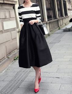 Satin material midi skirt with slight puffy effect. Available in 3 sizes http://clubyi.bigcartel.com/product/tea-length-satin-black-ball-skirt