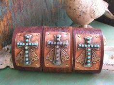My version of the popular sideways cross bracelets.  Soldered elements on vintage upcycled belt leather