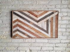 This one of a kind wall art is made from reclaimed lath wood. The finish is left completely natural to give it rustic character and interest. This piece will add warmth and character to any room and is sure to be a conversation piece. The bold geometric design would be a good great