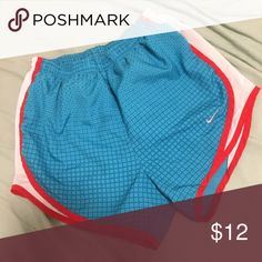 NIKE Patterned Running Shorts Blue square pattern with red and white siding. In great condition! Not worn much, just doesn't fit anymore. Nike Shorts