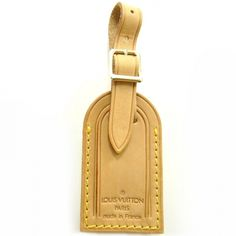 Track your luggage in style! This is an authentic LOUIS VUITTON Vachetta Leather Luggage Tag.   This is crafted from the same sturdy vachetta cowhide leather used on most Louis Vuitton handbags and luggage for the handles and leather trim.