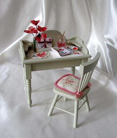 ExquisiteArtist's Deskand Chairare finished in a Cream  Thedesk is filled with an assortment of accessories.