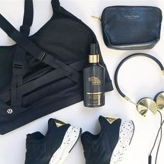 some black and gold essentials for today ⭐️✔️ in absolute love with @bondisands liquid gold - can't beat it for a no fuss beautiful tan  the @lululemon bra is a must have for busty gals  such good support and of course my @frends headphones are a gym essential also  happy humpday xxxxxx #flatlay #flatlayapp #flatlays www.theflatlay.com