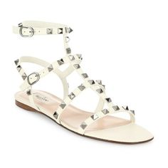Valentino Rockstud Leather Flat Sandals ($945) ❤ liked on Polyvore featuring shoes, sandals, ivory, monk-strap shoes, ivory flat sandals, caged sandals, strap sandals and leather shoes