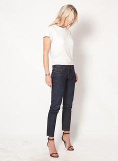 Dark blue jeans, white t-shirt, open high heels