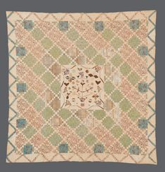 Collections | Quilt Museum and Gallery, York: Central square containing applied shapes in different printed cottons, including a branching tree in a pot, leaves, flowers, hearts and birds. This is surrounded by large pieced blocks of squares which form a diagonal lattice effect, and a border of triangles. The fabrics in the central area date from the 1820s, whilst the outer pieced squares frame dates from the 1840s. There is a cross stitched name and date 'I (heart shape) M March 8 1844'.